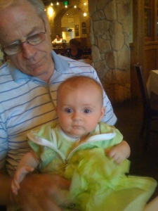 My dad Hans holding his granddaughter (my niece) Violet in May 2009
